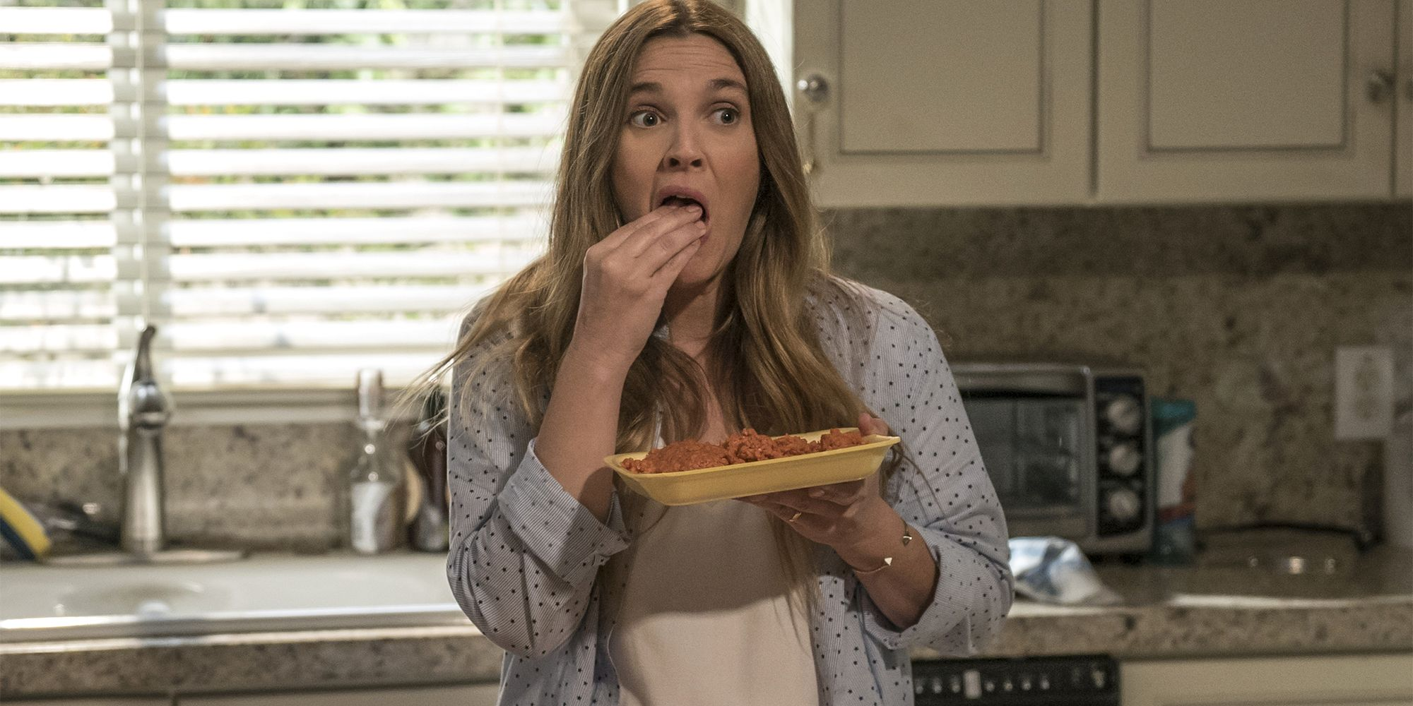 "<p>Drew Barrymore's long-mysterious Netflix comedy unveiled its cheerfully grisly premise recently: Barrymore plays a suburban soccer mom whose unusual eating habits cause some disruption within her cozy family life. (Spoiler: She's a zombie, but prefers not to use that term.) <span class=""redactor-invisible-space"" data-verified=""redactor"" data-redactor-tag=""span"" data-redactor-class=""redactor-invisible-space""></span></p><p><em data-verified=""redactor"" data-redactor-tag=""em"">Santa Clarita Diet</em><span class=""redactor-invisible-space""> premieres Friday, February 3 with 13 episodes on Netflix<span class=""redactor-invisible-space"">.</span></span><br></p>"