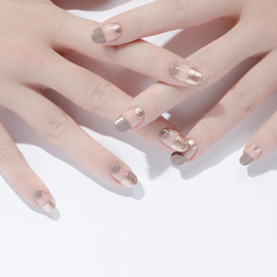 """<p>To keep metallic lacquer looking understated and airy, balance it with a neutral greige and a soft&nbsp&#x3B;oval shape.</p><p><span data-redactor-tag=""""span"""" data-verified=""""redactor""""></span><em data-redactor-tag=""""em"""" data-verified=""""redactor""""><a href=""""https://www.instagram.com/p/BCWHdoEyBKb/?taken-by=cassmariebeauty"""" target=""""_blank"""" data-tracking-id=""""recirc-text-link"""">@cassmariebeauty</a></em></p><p><em data-redactor-tag=""""em"""" data-verified=""""redactor""""></em></p><p><em data-redactor-tag=""""em"""" data-verified=""""redactor""""></em></p><p><em data-redactor-tag=""""em"""" data-verified=""""redactor""""></em><span class=""""redactor-invisible-space"""" data-verified=""""redactor"""" data-redactor-tag=""""span"""" data-redactor-class=""""redactor-invisible-space""""><em data-redactor-tag=""""em"""" data-verified=""""redactor""""></em></span></p>"""