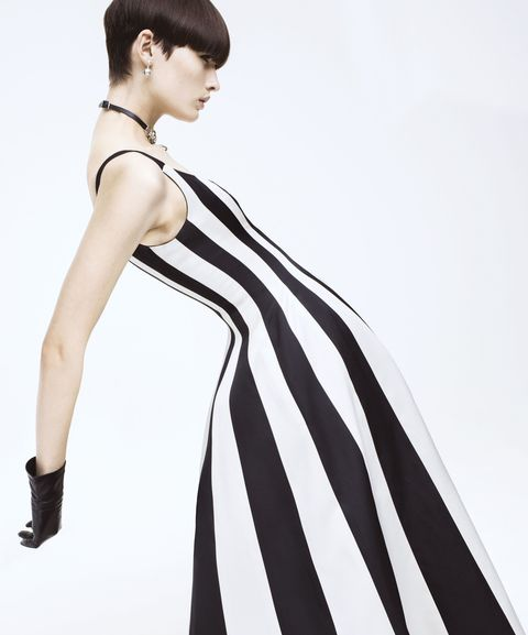 Hairstyle, Sleeve, Shoulder, Joint, Style, Formal wear, Dress, Fashion model, Fashion accessory, One-piece garment,