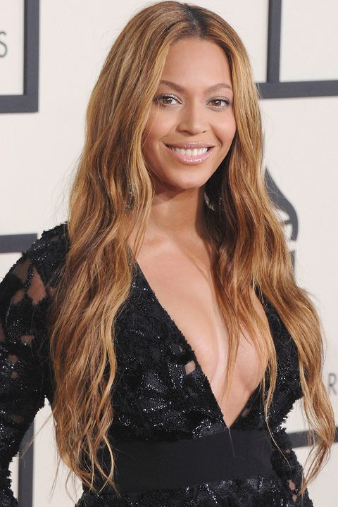 "<p>Color chameleon Beyoncé Knowles lightens up her long,&nbsp;loose waves with golden tones.<span class=""redactor-invisible-space"" data-verified=""redactor"" data-redactor-tag=""span"" data-redactor-class=""redactor-invisible-space""></span></p>"