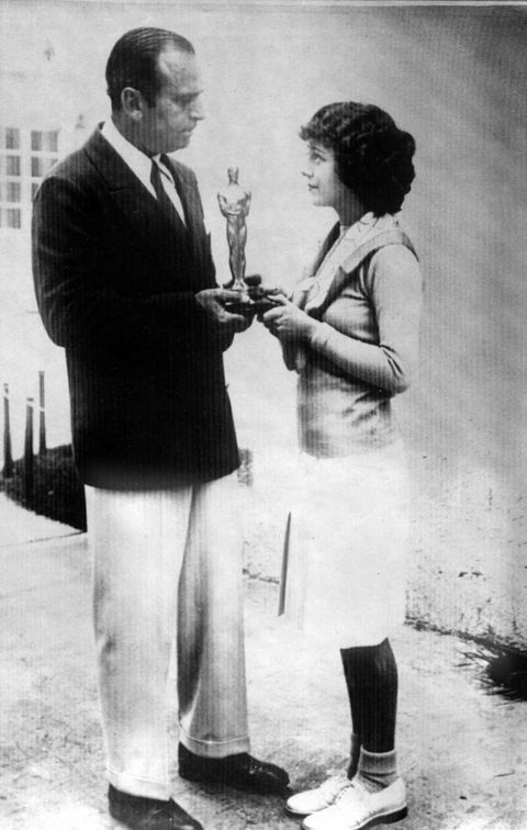 "<p>At the first Academy Awards, winners were announced three months in advance and were chosen on the basis of all their film work during the calendar year. The girlish Janet Gaynor won the first Best Actress award, here accepting the statue, pre-ceremony, from Academy president Douglas Fairbanks.<span class=""redactor-invisible-space"" data-verified=""redactor"" data-redactor-tag=""span"" data-redactor-class=""redactor-invisible-space""></span></p>"