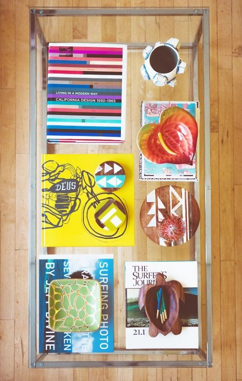 <p>We&nbsp;know, we know, you're already styling with (and hopefully reading) coffee table books. But instead of stacking them, consider splaying them out in a neat grid and layering the rest of your pieces on top.&nbsp;</p>