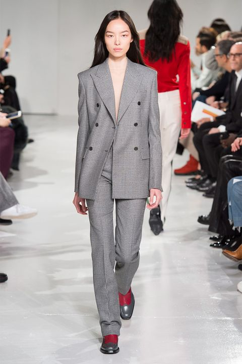 Clothing, Footwear, Fashion show, Event, Trousers, Red, Outerwear, Runway, Formal wear, Coat,