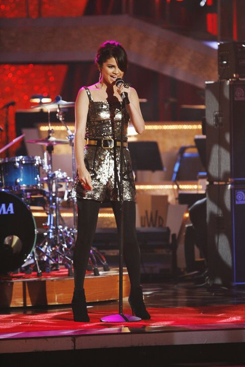 """<p>Selena and her old backing band The Scene performed """"Falling Down"""" from her first album&nbsp;<em data-verified=""""redactor"""" data-redactor-tag=""""em"""">Kiss &amp; Tell</em><span class=""""redactor-invisible-space"""" data-verified=""""redactor"""" data-redactor-tag=""""span"""" data-redactor-class=""""redactor-invisible-space"""">&nbsp;on&nbsp;<em data-verified=""""redactor"""" data-redactor-tag=""""em"""">Dancing With the Stars</em><span class=""""redactor-invisible-space"""" data-verified=""""redactor"""" data-redactor-tag=""""span"""" data-redactor-class=""""redactor-invisible-space""""> way back in 2009. So many sequins, so little time.</span></span> </p>"""
