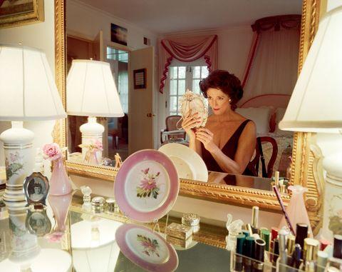<p>Mum applying make-up, Washington D.C., 1994</p>
