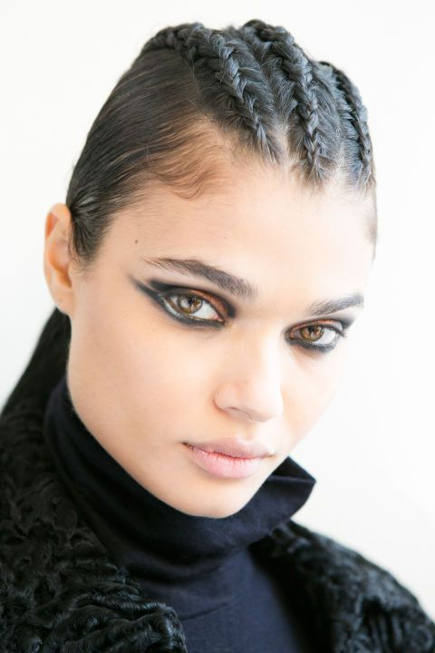 "<p>For Balmain this season, hairstylist Sam McKnight braided three or four cornrows along the center of the head (""in an imaginary mohawk,"" he said), then pulled the hair back into a tight ponytail. Extensions were added for length, so that the tails reached the middle of the models' backs. A root cover-up powder in shade darker than the models' hair was used along the braids to cover the skin, and then McKnight's namesake styling products (launching later this year) added the grit and hold needed to keep the look in place. ""She's tougher and more warrior-like than in the past,"" said the hairstylist. <span class=""redactor-invisible-space""></span></p>"