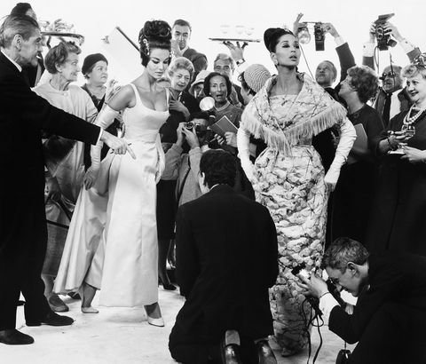 "<p>Margot McKendry and China Machado with members of the French Press, dresses by Lanvin-Castillo and Heim, Paris studio, August 24, 1961<span class=""redactor-invisible-space"" data-verified=""redactor"" data-redactor-tag=""span"" data-redactor-class=""redactor-invisible-space""></span></p>"