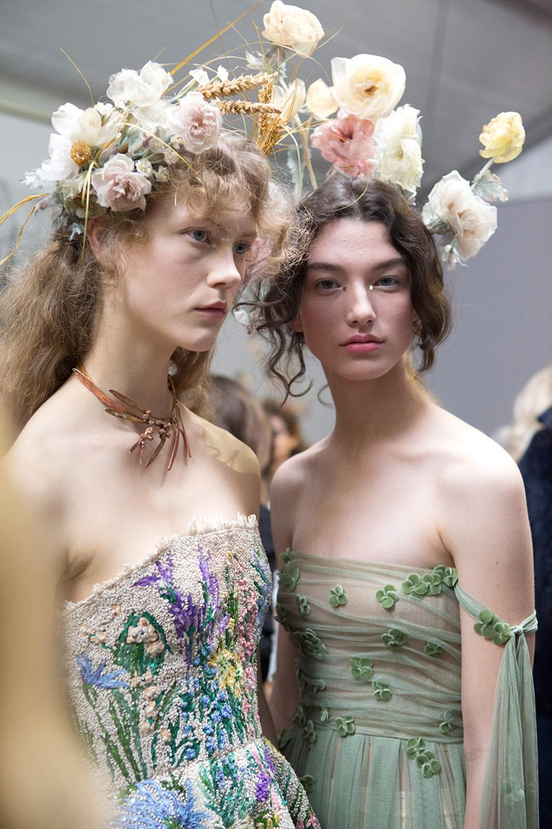 <p>At Dior's Haute couture show, models walked the runway looking like Disney princesses come to life—with the ethereal gowns and floral crows to match.</p>