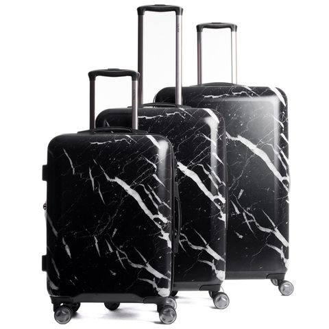 """<p>Your go-to luggage, like any of your other basics, is the key to seamlessly (and strategically) navigating the check-in, or carry-on, process. While choosing something that feels fun on the outside adds to the appeal–and will make you more inclined to want to check one and carry-on another to show them off–opting for a set that has interior compartments&nbsp;that suit your style is even more essential. To pack like the fashion set, choose hard-case,&nbsp;double-wide options that maximize space, protect valuables and are more easily lived out of should you choose not to unpack.</p><p><em data-redactor-tag=""""em"""" data-verified=""""redactor"""">CalPak 3-piece luggage set, $365, <a href=""""https://www.calpaks.com/collections/luggage/products/astyll-3-piece-luggage-set-midnight-marble"""" target=""""_blank"""" data-tracking-id=""""recirc-text-link"""">calpak.com</a>.</em></p>"""