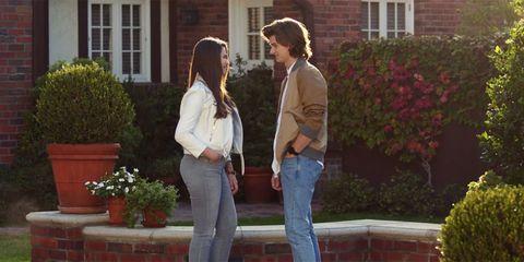 Window, Trousers, Denim, Jeans, Shirt, Flowerpot, Outerwear, T-shirt, Interaction, Shrub,