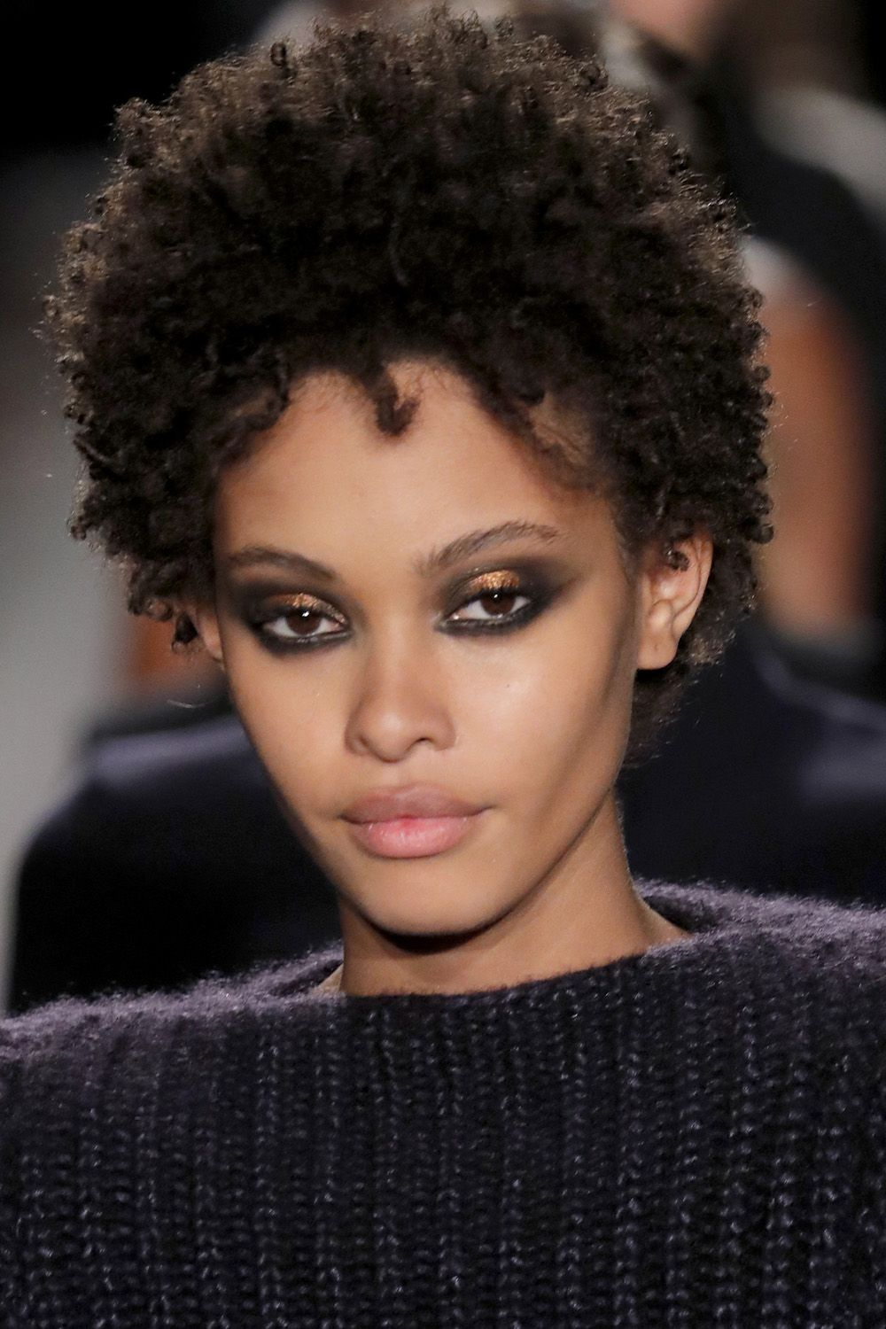 "<p>An eye look as strong and unapologetic as the women who wore it on the runway at Brandon Maxwell. ""We are embracing the difference in the looks, it's the same makeup with different colors,"" says makeup artist Tom Pecheux, who painted the strong black-and-metallic eyeshadow on each model. ""I love the fact that it's the same, but it's not the same color. Like human beings—we are the same, but we are all different colors."" <span class=""redactor-invisible-space""></span></p>"