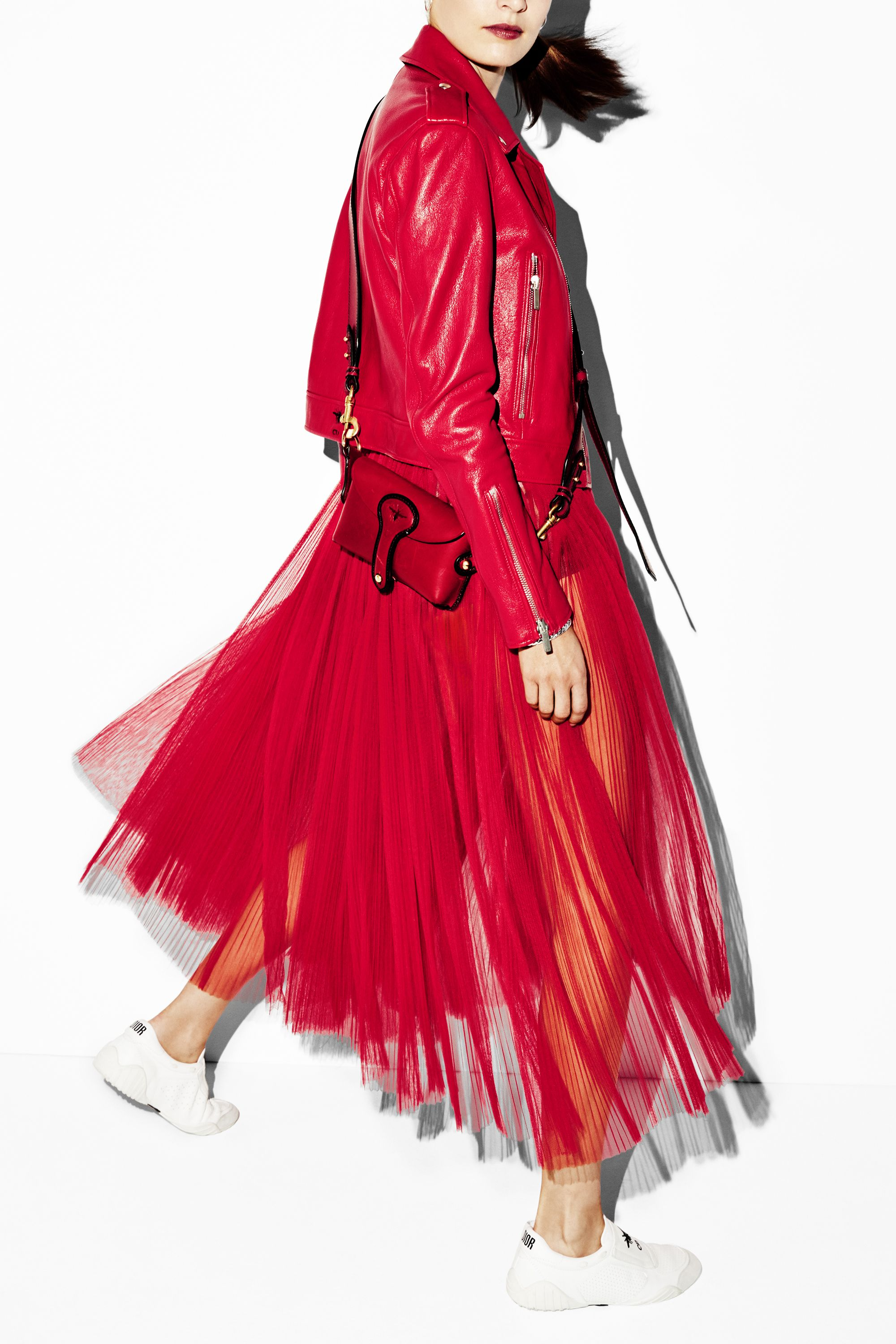 "<p><span>The versatile style transitions </span><span>easily from day to night.</span></p><p><span></span><em data-redactor-tag=""em"" data-verified=""redactor""><span>Dior jacket, $4,400, skirt, $3,600, bag, $2,100, and sneakers, $920, </span><span>800-929-DIOR; Pandora earrings, $40, <a href=""http://www.pandora.net/en-us"" target=""_blank"" data-tracking-id=""recirc-text-link"">pandora.net</a>; Phillip Gavriel </span></em><span><em data-redactor-tag=""em"" data-verified=""redactor"">Fine Jewelry bangle, $245, <a href=""http://phillipgavriel.com/index2.php"" target=""_blank"" data-tracking-id=""recirc-text-link"">phillipgavriel.com</a>.</em></span></p>"