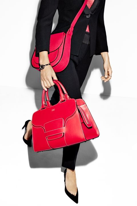 "<p>Contrast piping gives a&nbsp;<span>retro silhouette a modern edge, and a structured weekender is the perfect accessory for any getaway.&nbsp;</span></p><p><span></span><em data-redactor-tag=""em"" data-verified=""redactor"">Giorgio&nbsp;Armani jacket, $2,725, top, $875, pants, $1,345, bags, $1,695–$2,495,&nbsp;and shoes, $595, <a href=""http://www.armani.com/us"" target=""_blank"" data-tracking-id=""recirc-text-link"">armani.com</a>; Bulgari watch, $3,200, <a href=""http://www.bulgari.com/en-us/"" target=""_blank"" data-tracking-id=""recirc-text-link"">bulgari.com</a>;&nbsp;</em><span><em data-redactor-tag=""em"" data-verified=""redactor"">Tous ring, $119, <a href=""http://www.tous.com/us-en/"" target=""_blank"" data-tracking-id=""recirc-text-link"">tous.com</a>.&nbsp;</em></span></p><p><span></span></p>"