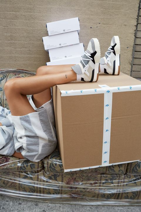 Footwear, Cardboard, Box, Shoe, Carton, Leg, Package delivery, Paper product, Furniture, Table,