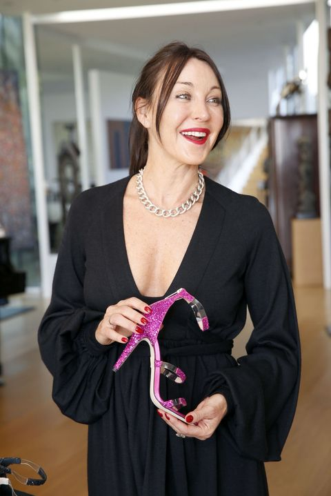 Tamara Mellon With A Pair Of Heels From Her Namesake Label