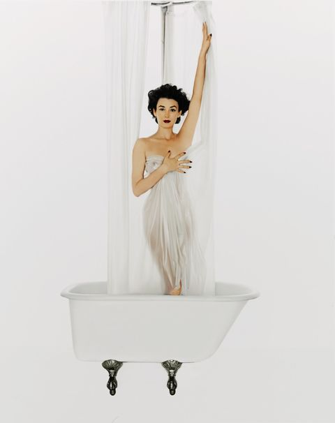 White, Shoulder, Dress, Joint, Room, Plumbing fixture, Curtain, Performance, Interior design,