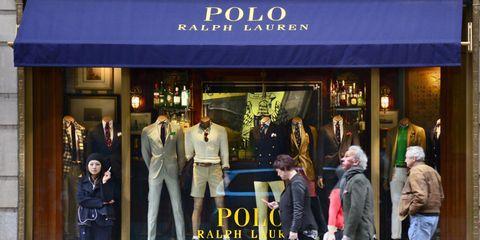 Retail, Coat, Jacket, Display window, Fashion, Blazer, Street fashion, Luggage and bags, Door, Mannequin,