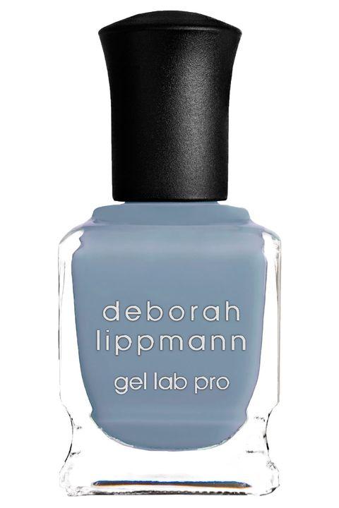 Nail polish, Blue, Product, Nail care, Cosmetics, Water, Liquid, Material property, Nail,