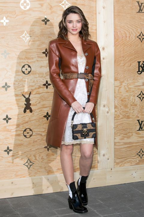 Clothing, Dress, Fashion, Fashion model, Brown, Footwear, Latex clothing, Leather, Leg, Outerwear,