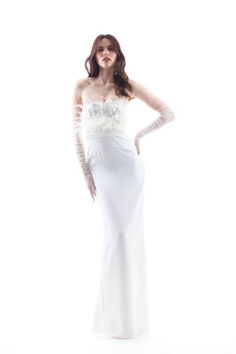 Clothing, Dress, Sleeve, Skin, Shoulder, Bridal clothing, Textile, Standing, Strapless dress, Joint,