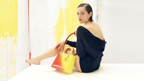 Yellow, Bag, Luggage and bags, Black hair, Waist, Lipstick, Shoulder bag, Model, Handbag, Bun,