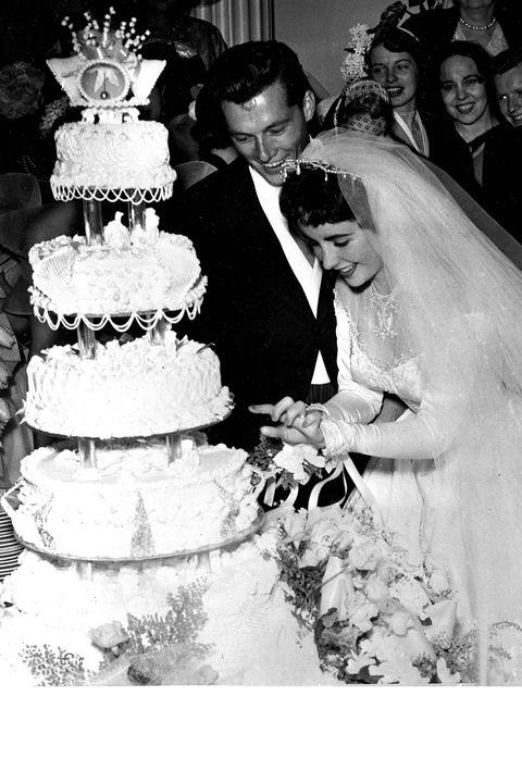 Clothing, Cake, Event, Bridal veil, Dessert, Baked goods, Sweetness, Cuisine, Coat, Bridal clothing,