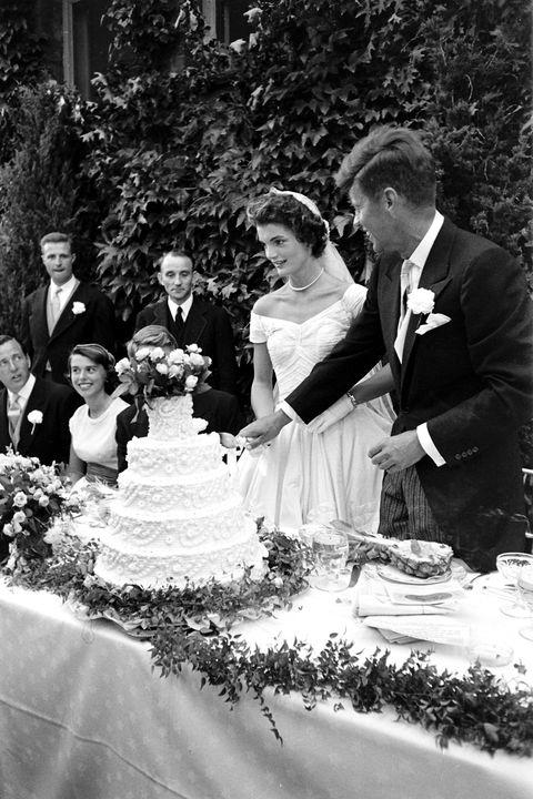 Clothing, People, Event, Coat, Trousers, Dress, Petal, Suit, Photograph, Bridal clothing,