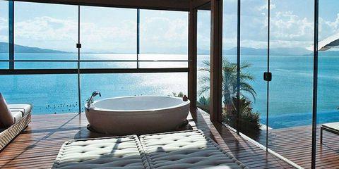Daylighting, Real estate, Interior design, Azure, Resort, Outdoor furniture, Shade, Coffee table, Tropics, Transparent material,