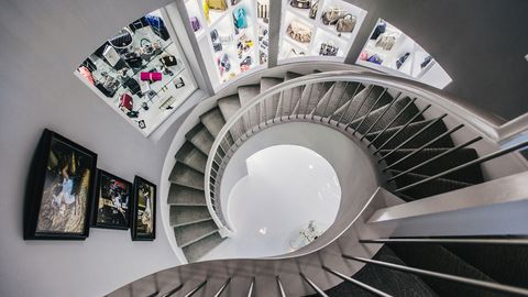 Interior design, Stairs, Picture frame, Art, Collection, Space, Material property, Design, Circle, Engineering,