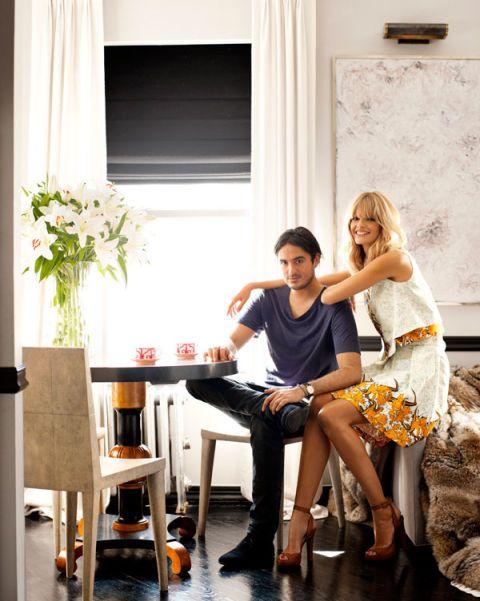 Leg, Trousers, Interior design, Room, Dress, Sitting, Furniture, Interior design, Window covering, Window treatment,