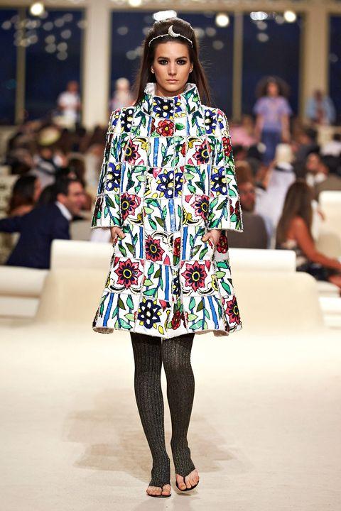 Shoulder, Fashion show, Human leg, Runway, Style, Fashion model, Pattern, Street fashion, Fashion, Beauty,
