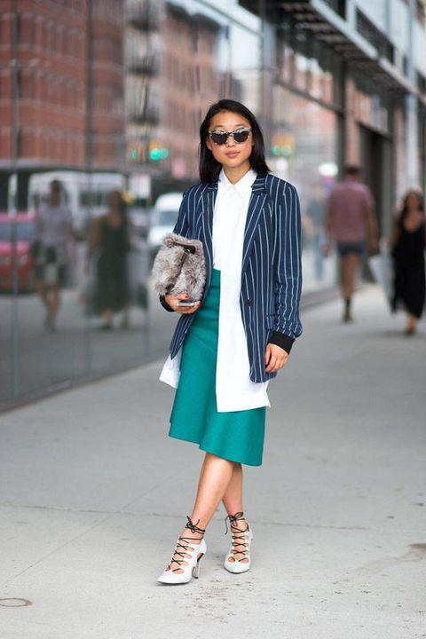 Clothing, Eyewear, Sleeve, Shoulder, Sunglasses, Textile, Joint, Outerwear, Bag, Street,