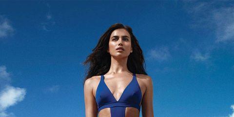 Blue, Shoulder, Coastal and oceanic landforms, Human leg, Summer, Swimwear, Aqua, Thigh, Beach, Ocean,
