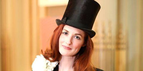 Hat, Formal wear, Collar, Style, Coat, Bouquet, Headgear, Costume accessory, Fashion, Blazer,