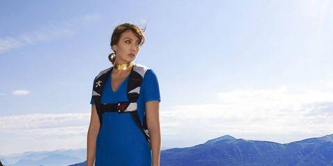 Clothing, Dress, Shoulder, Mountainous landforms, Human leg, Highland, One-piece garment, Electric blue, Day dress, Mountain range,