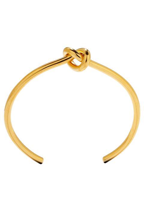 Yellow, Amber, Orange, Tan, Beige, Natural material, Metal, Knot, Brass, Gold,