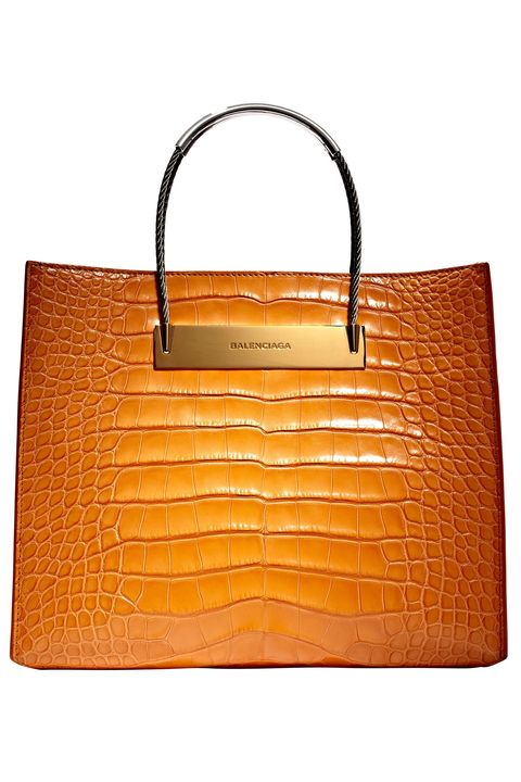 Product, Brown, Bag, Orange, Fashion accessory, Amber, Luggage and bags, Leather, Shoulder bag, Font,
