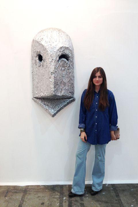 Trousers, Denim, Outerwear, Jacket, Street fashion, Scarf, Visual arts, Bag, Modern art, Pocket,