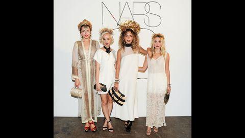 Dress, Fashion, One-piece garment, Day dress, Headpiece, Fashion design, Sandal, Hair accessory, Fashion model, Embellishment,