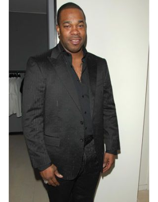 busta rhymes at versace menswear launch party at barneys