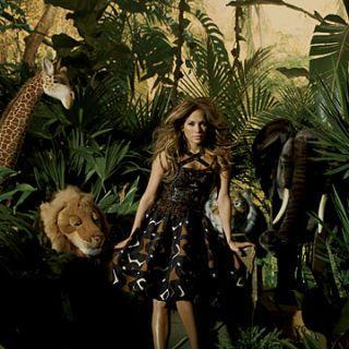 jennifer lopez posing in safari wearing an oscar de la renta dress and louis vuitton platforms