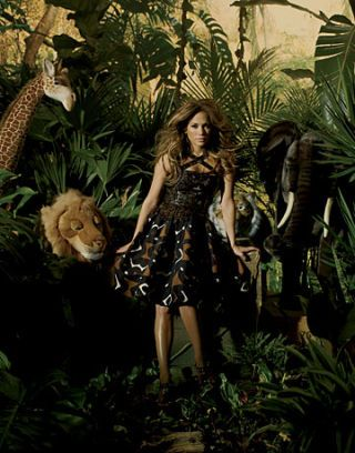 jennifer lopez posing in safari wearing an oscar de la renta dress and louis vuitton platforms