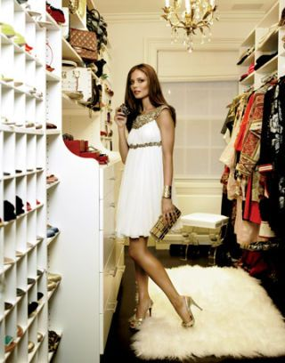 georgina chapman in marchesa dress posing in her closet
