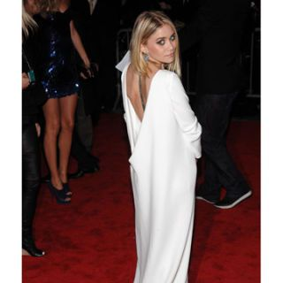 ashley olsen in a white gown by the row