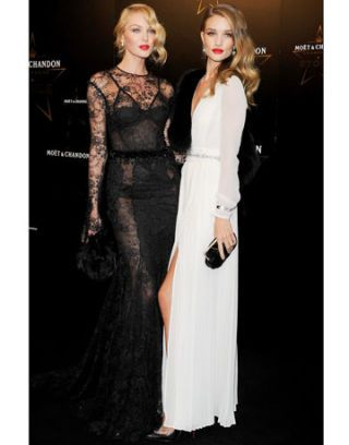Candice Swanepoel in Tom Ford and Rosie Huntington-Whiteley in Burberry