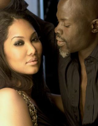 kimora lee simmons in a kls gown and djimon hounsou in a gucci button up