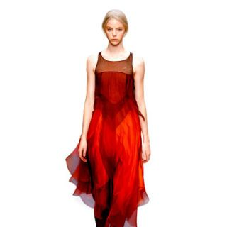 modeling wearing bright red on the celine runway