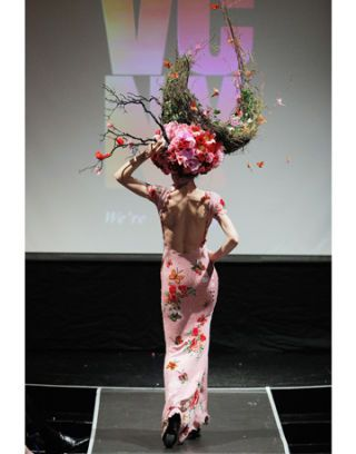 model with a pink headdress
