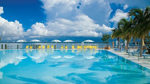 Swimming pool, Cloud, Water, Aqua, Resort, Reflection, Azure, Sunlounger, Cumulus, Tropics,