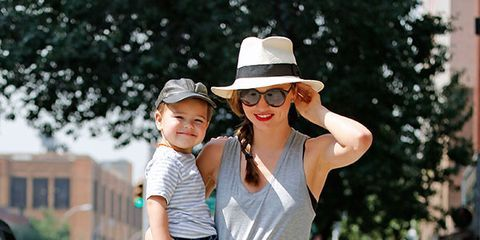Hat, Sun hat, Bicycle wheel, Bicycle frame, Bicycle tire, Fashion accessory, Street, Street fashion, Bicycle, Fedora,
